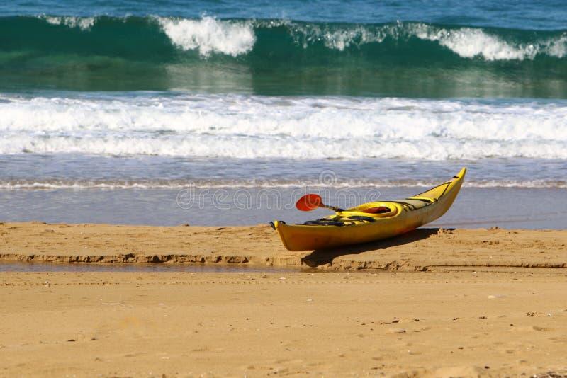 Kayak on the beach royalty free stock photos