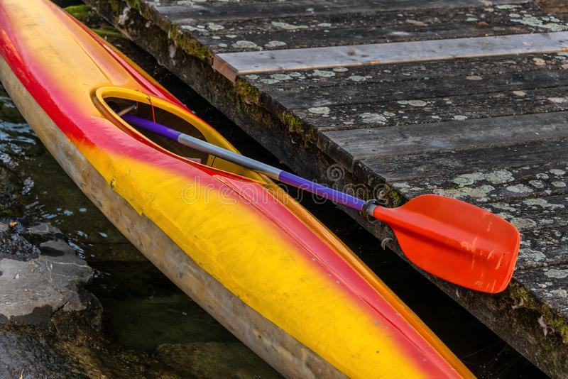 Old retro colorful Kayak on pier royalty free stock image