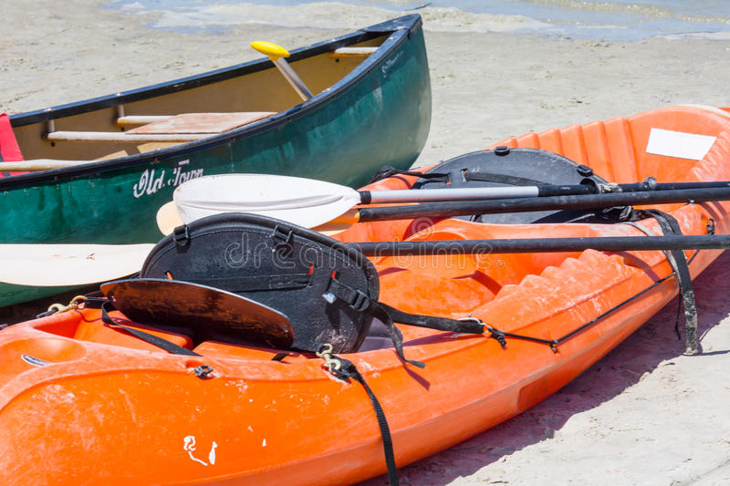 Kayak and Canoe. A kayak and canoe are beached after a day in the surf royalty free stock images