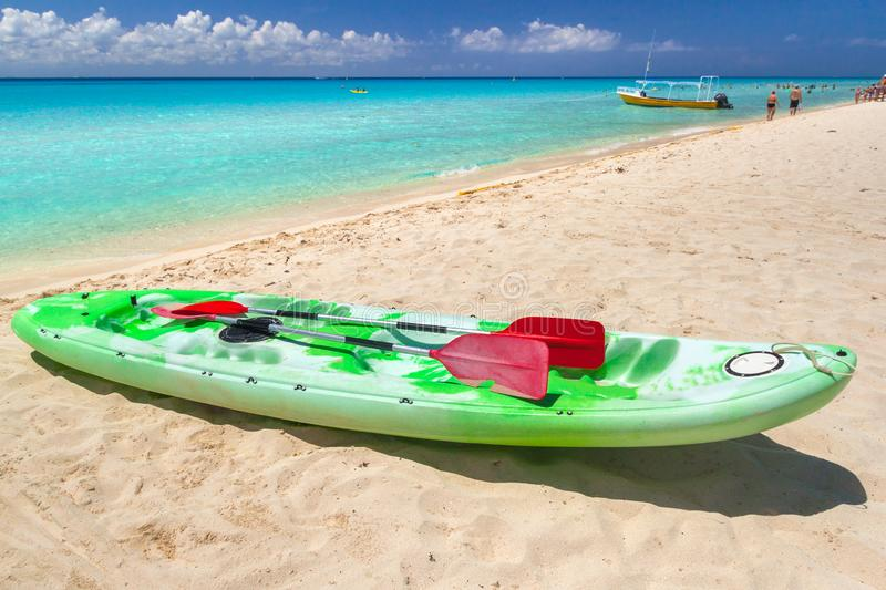 Kayak at the Caribbean Sea in Playa del Carmen, Mexico. Beach sunlight coast boat nobody tropical travel sunrise new destinations sand celebration summer stock photo