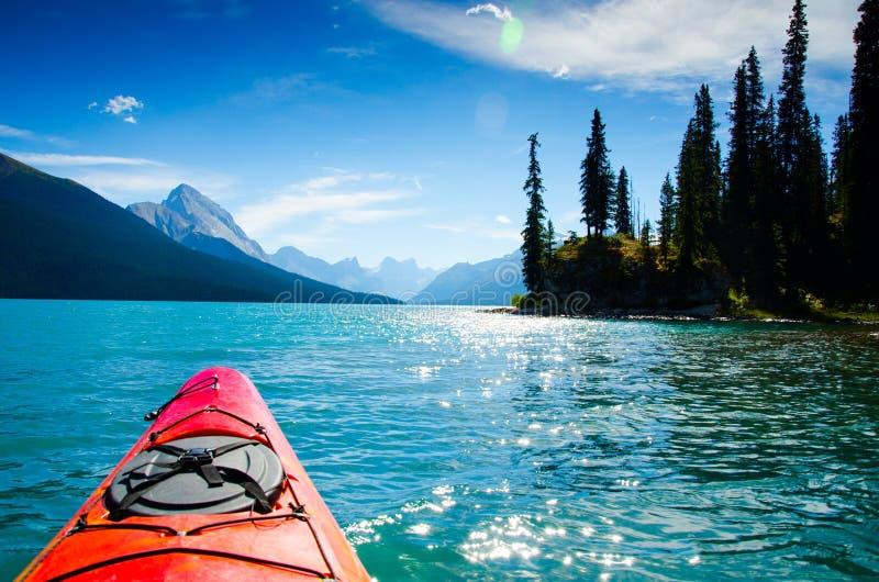 Kayak on lake in Canada. Kayak on lake with mountain range in background, Canada stock photography