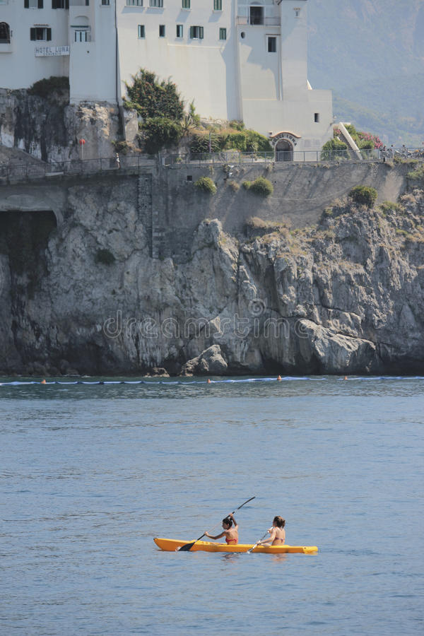 Kayak paddlers in Amalfi, Italy royalty free stock image