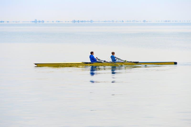 Kayak paddling teenagers royalty free stock photography