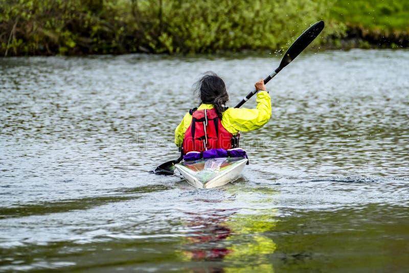 Kayak racing on the lake in Wales royalty free stock photo