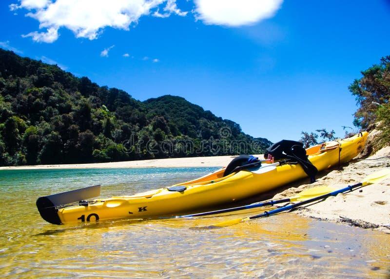 Kayak resting on a beach royalty free stock photo