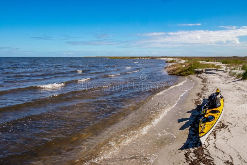 Kayak rests on the beach stock photo