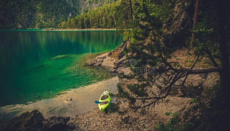 Kayak On Shore Of Lake In Forest royalty free stock images
