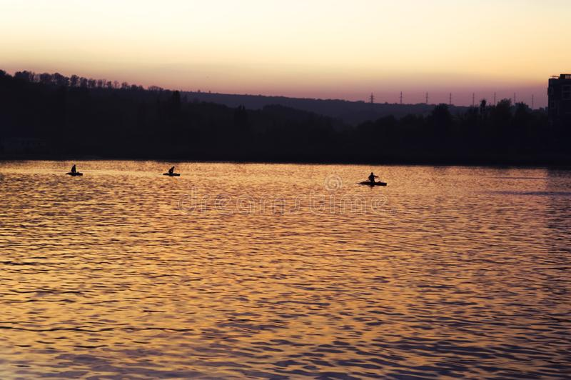 Kayak swim in the evening on the lake at sunset day stock image