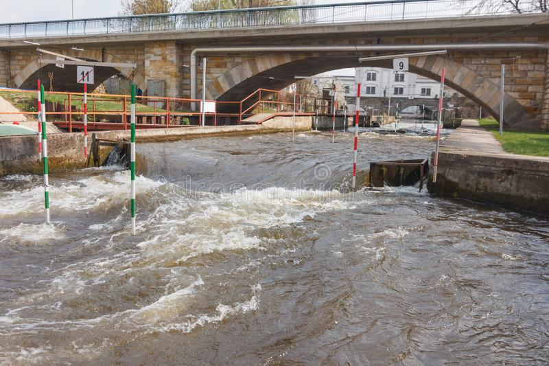 Kayak training, Kayak Race near the bridge where water strong whirlpools arise near the piles stock photos