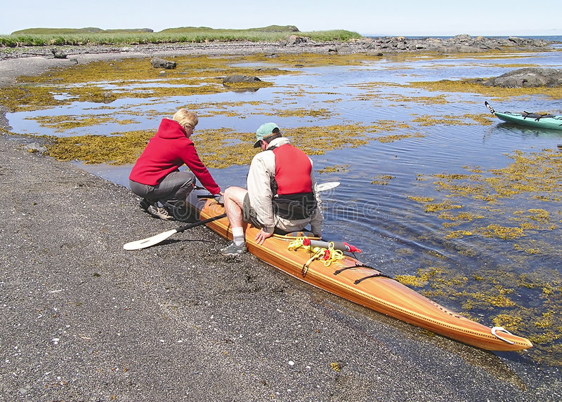 Kayak woman helper stock images