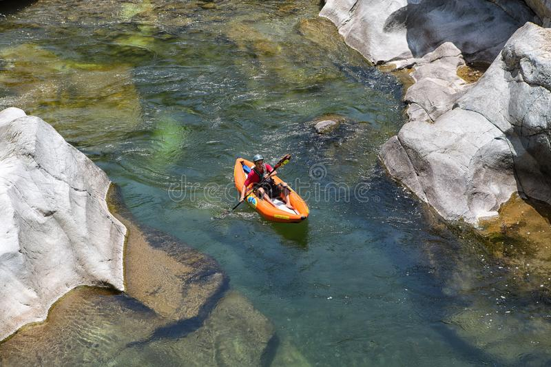 Kayaker on the Canrejal river in Honduras. April 17, 2015 La Ceiba, Honduras: the Canrejal river in the pico Bonito national park is a popular place for kayaking stock photos
