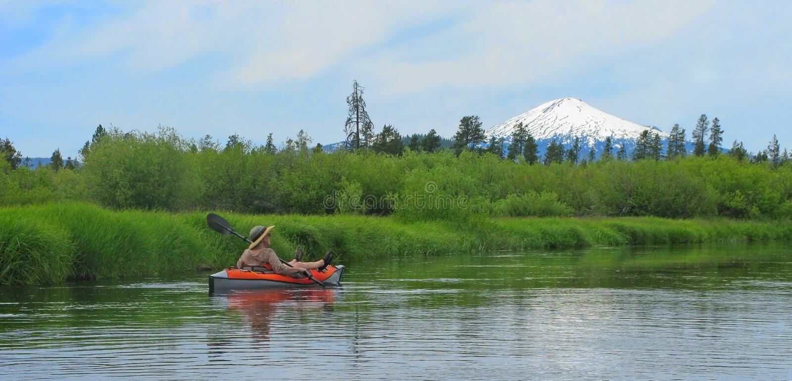 Kayaker on the Little Deschutes River royalty free stock photo