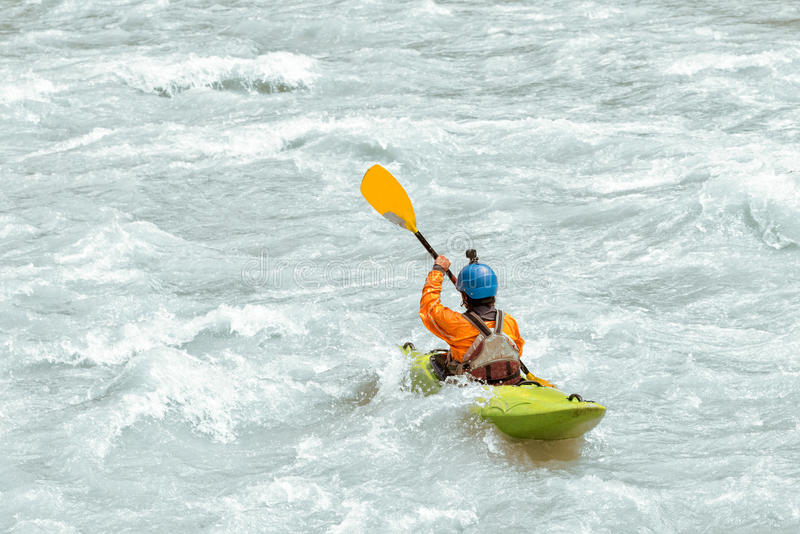 Kayaker paddling in white water rapids royalty free stock images