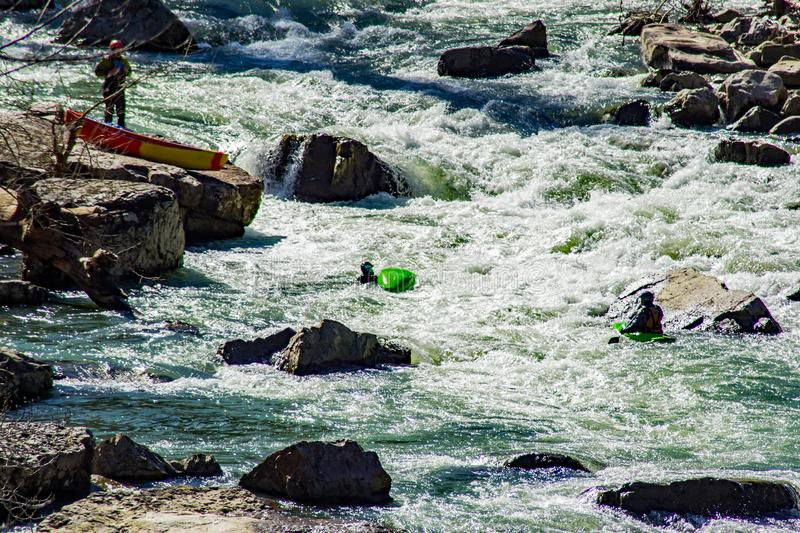 """Kayaker in Trouble in """"Devil's Kitchen"""" Rapids royalty free stock images"""