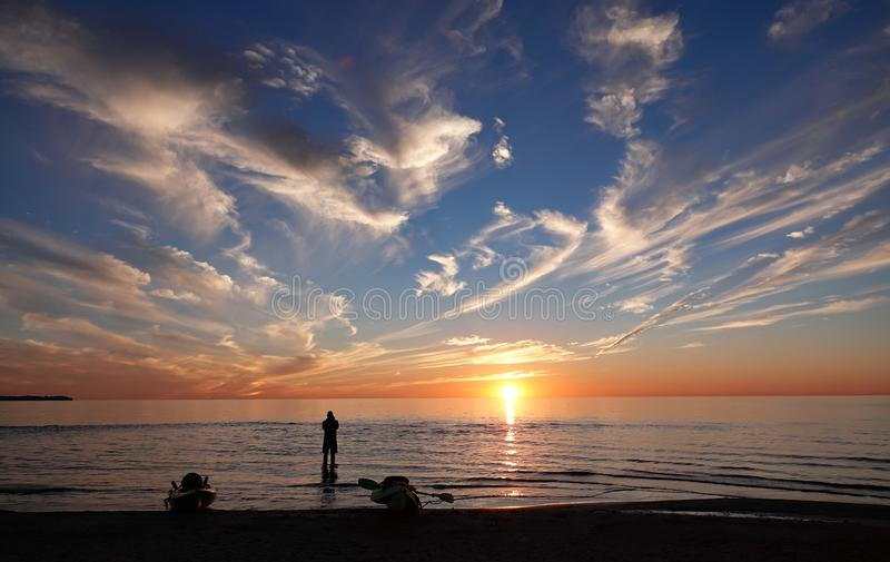 Kayaker Watching the Sunset over Lake Erie stock photos