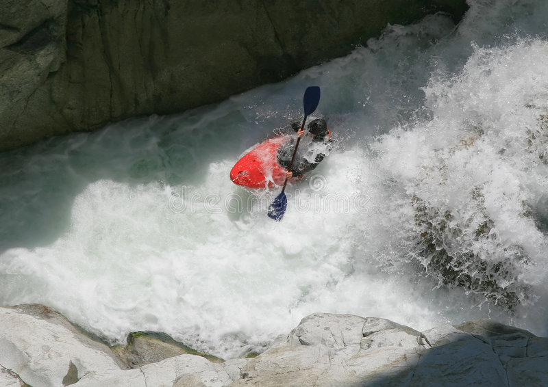 Kayaker in a whitewater royalty free stock photo