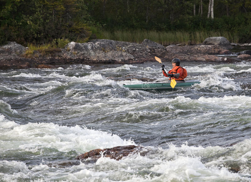 Kayaker in whitewater immagine stock