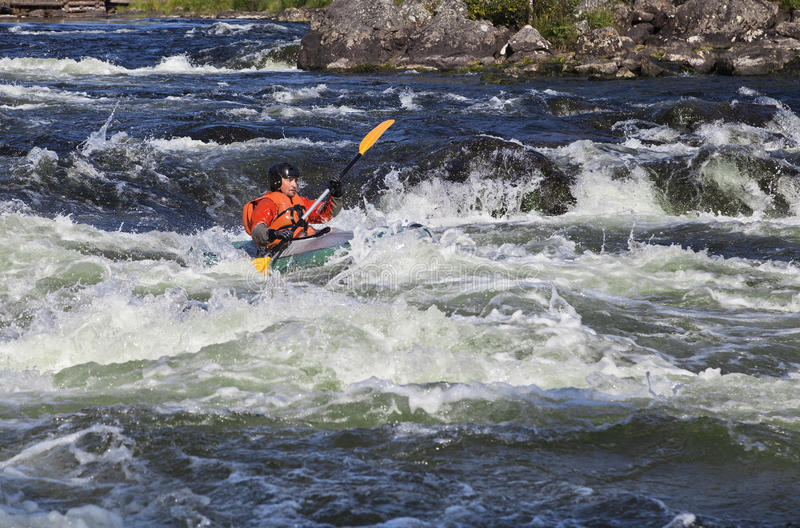 Kayaker in whitewater fotografia stock