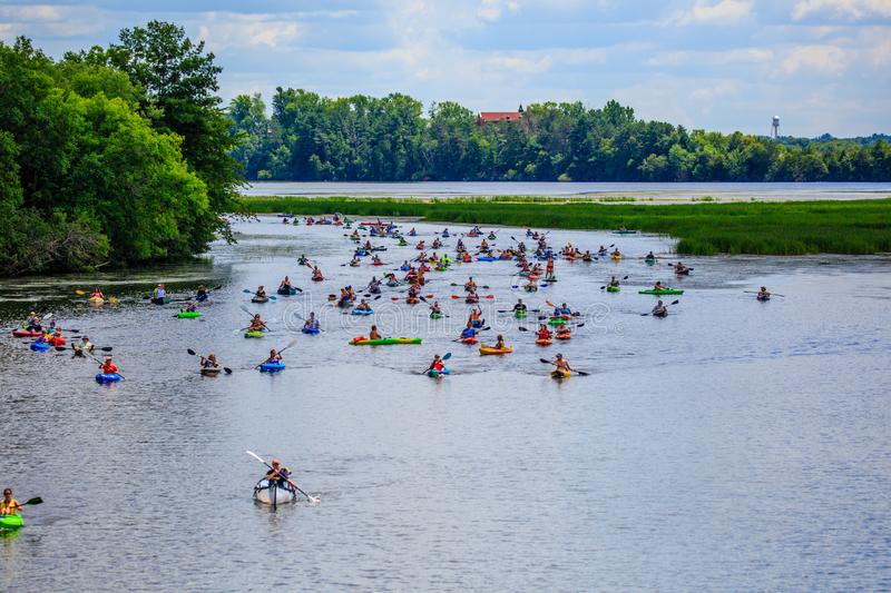 Kayakers coming around the corner at the 4th Annual Paddle Pub Crawl, Wausau, Wisconsin, USA, 7/28/18. Kayakers coming around the corner on Lake Wausau at the royalty free stock image