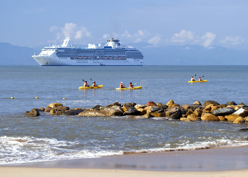 Kayakers and Cruise Ship stock image