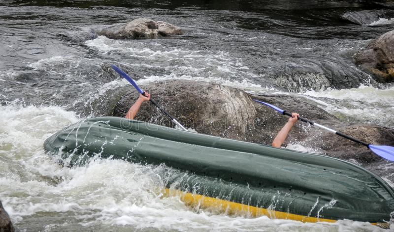 Kayakers fights the white water in a Pivdenny Bug river. stock photo