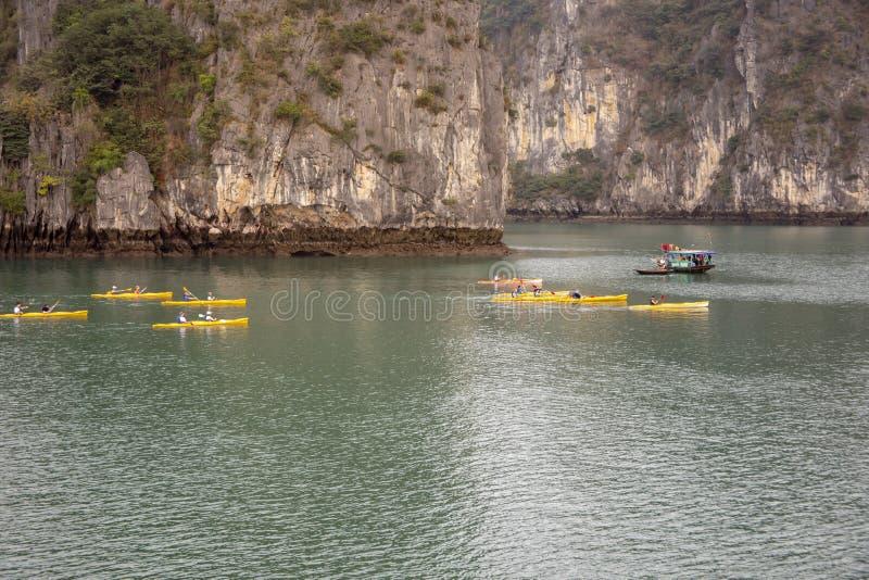 Kayakers in Ha Long Bay Vietnam stock image