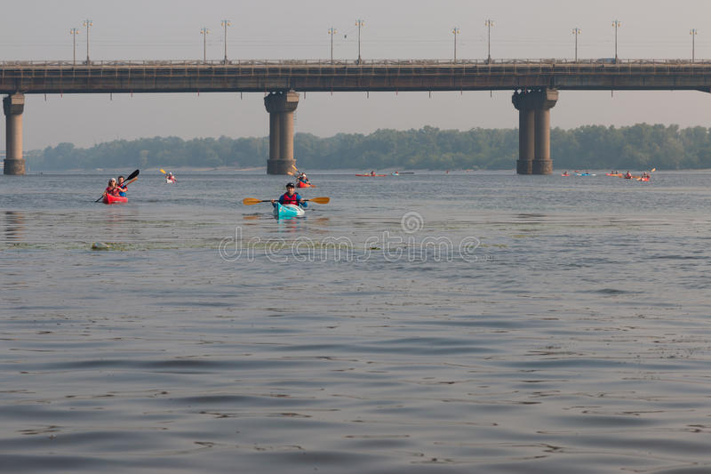 Kayakers on the river dnepr in kiev. Blue kayak royalty free stock images