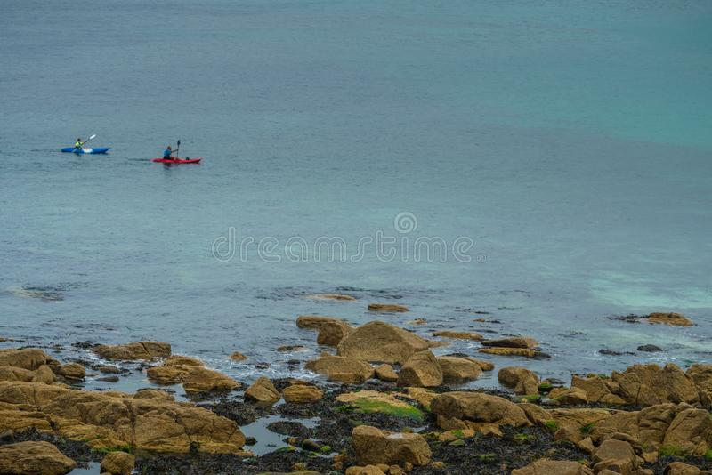 Kayakers in the Sennen Cove royalty free stock image