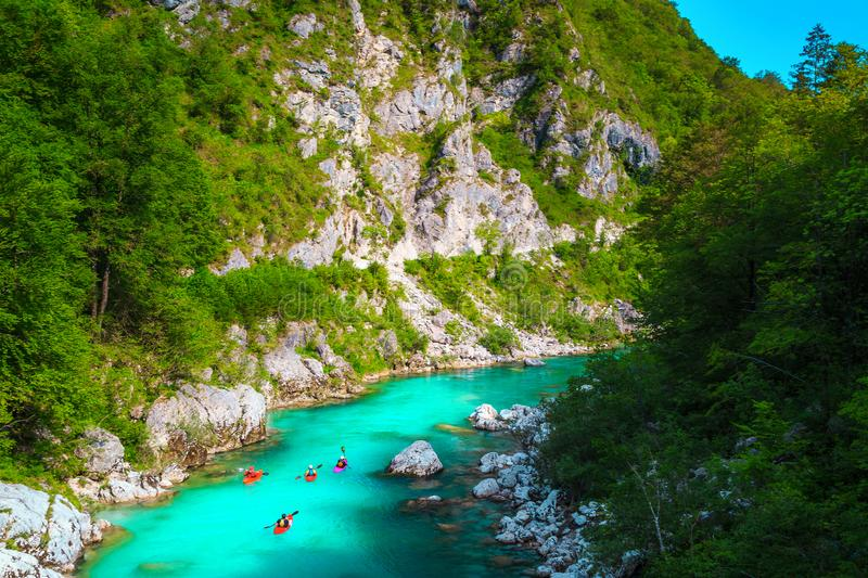 Kayakers on the spectacular turquoise Soca river, Kobarid, Slovenia stock image