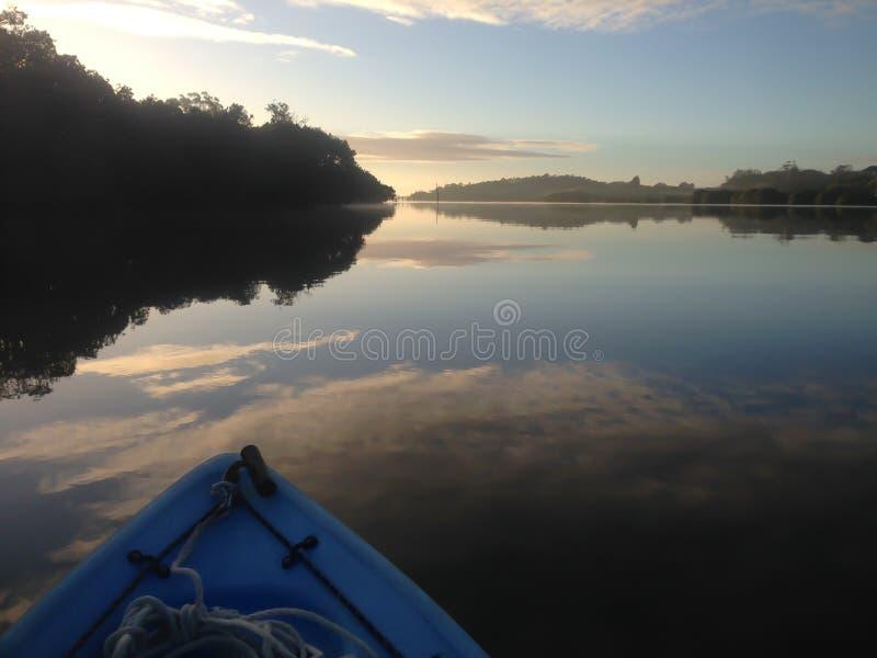 Kayaking on the Kerikeri Inlet, New Zealand, NZ, at dawn royalty free stock image