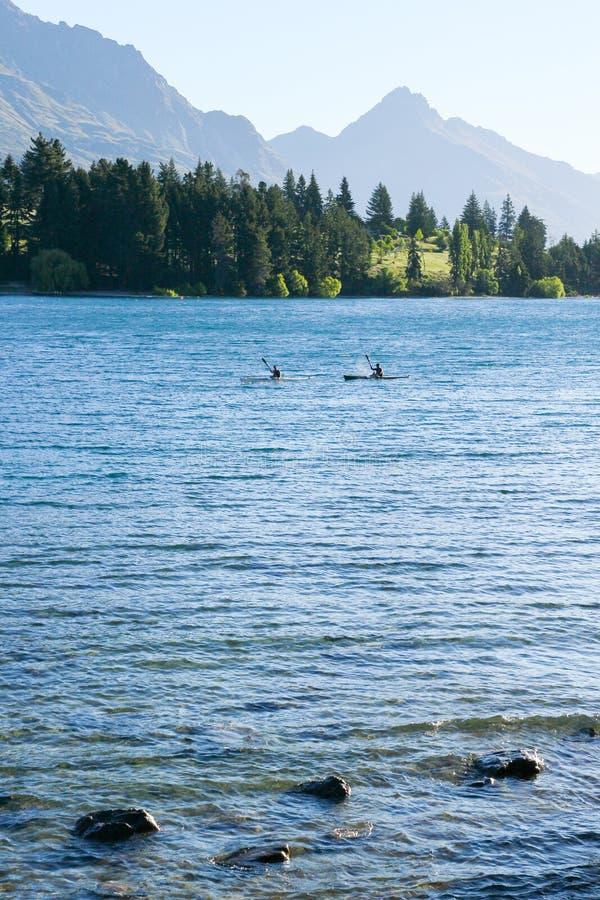 Kayaking in Lake Wakatipu in Early Morning royalty free stock images