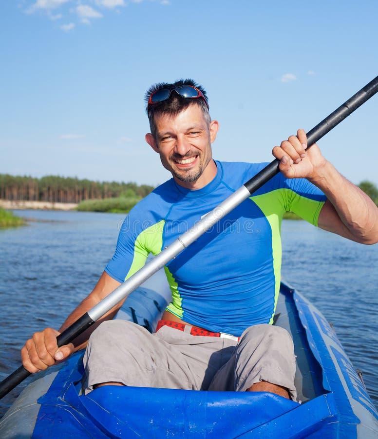 kayaking man royaltyfria bilder