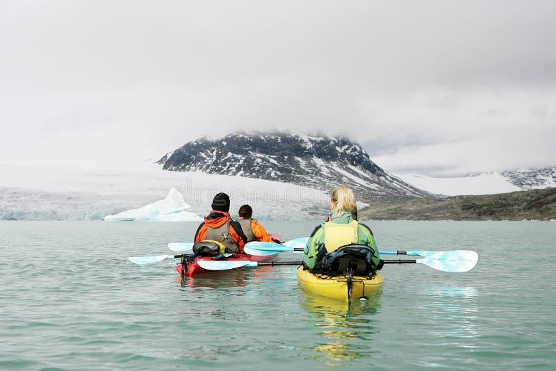Kayaking in norway royalty free stock photo