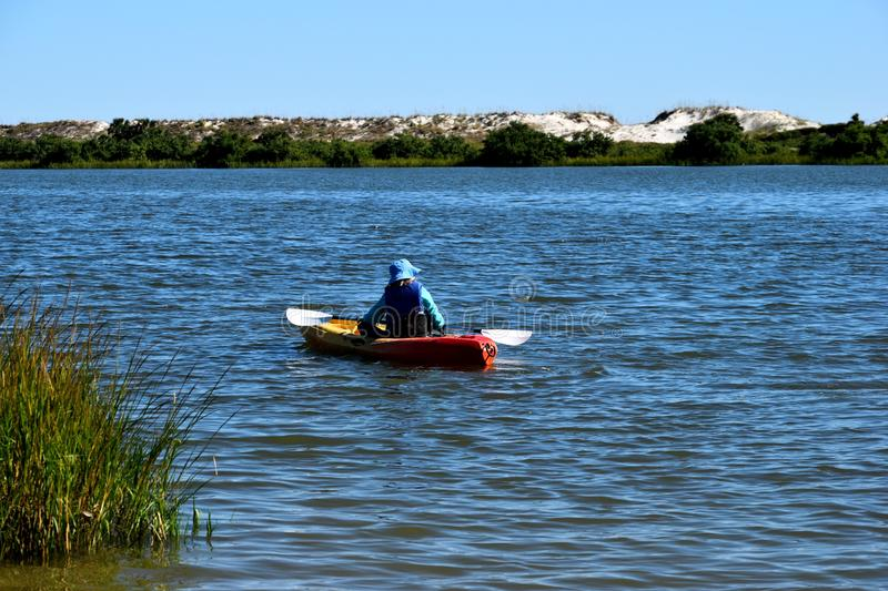 Kayaking by the ocean beach royalty free stock photography