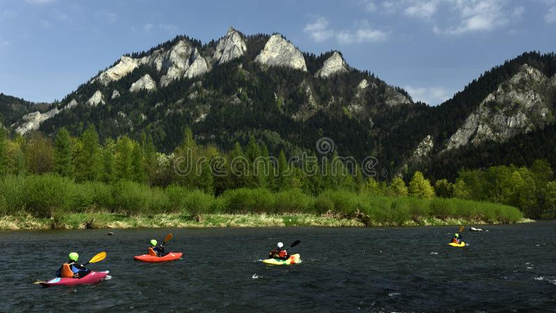 Kayaking in Pieniny, Spis region, Slovakia. Group of kayakers paddling on Dunajec river at Pieniny mountains in Spis region - Slovakia royalty free stock image