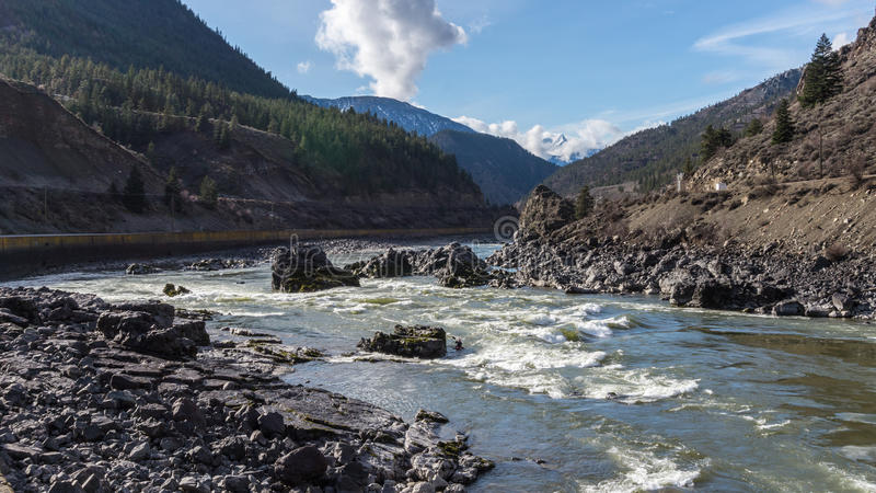 Kayaking in the Rapids of the Fraser River in the Fraser Canyon. The rapids in parts of the Fraser Riverare popular with avid kayakers. Kayakers enjoy the royalty free stock photos