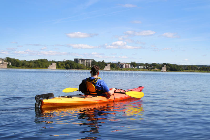 Kayaking on the river in Fredericton royalty free stock photo