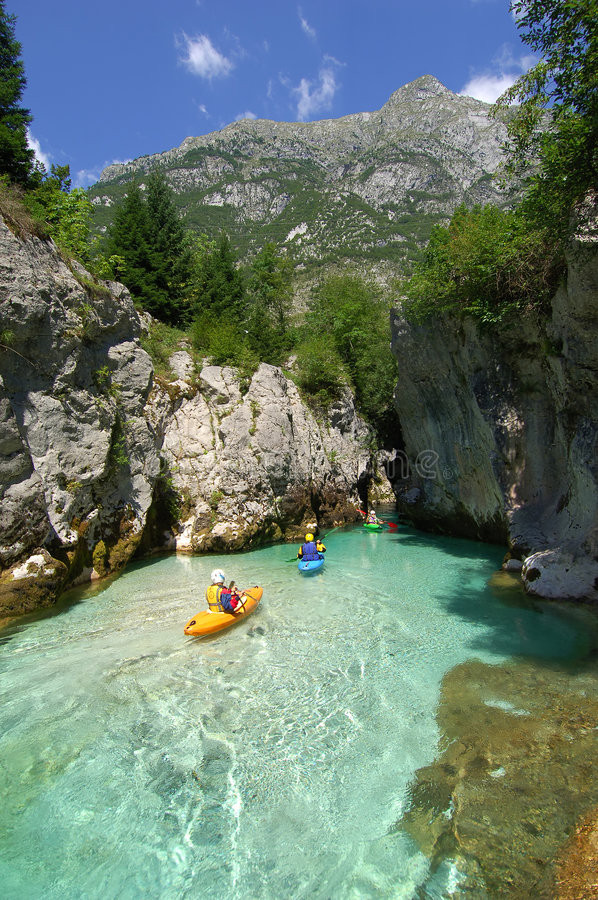 Kayaking through river gorge stock photo