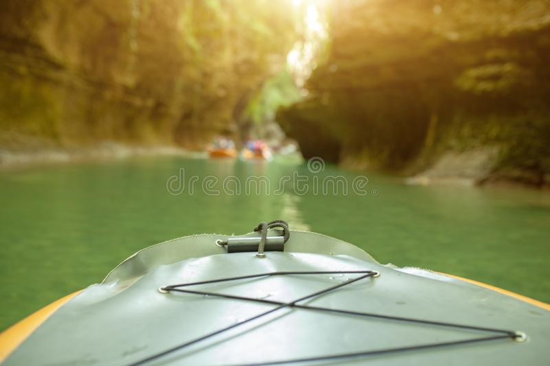 Kayaking on the river. group of people in a boat sailing along the river. Rowers with oars in a canoe. Rafting on a kayak. Leisure royalty free stock photography