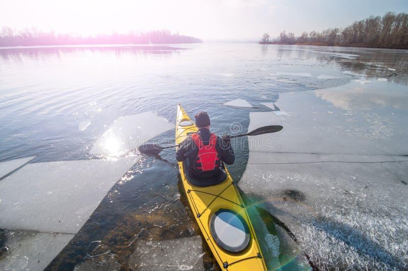 Kayaking in ukraine. Man kayak is on a frozen river stock photography