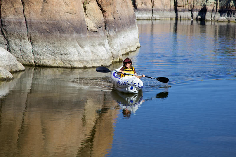 Kayaking on Watson Lake. Kayaking on scenic watson lake near prescott arizona with interesting granite rock formations royalty free stock images