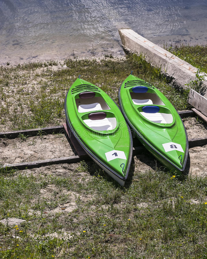 Kayaks on the Bank stock images