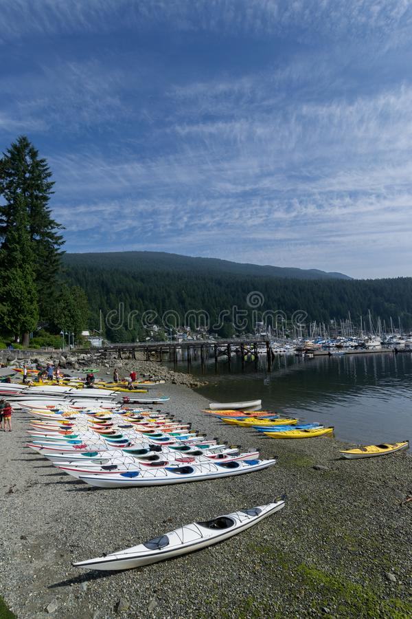 Kayaks on the Beach at Deep Cove stock photography