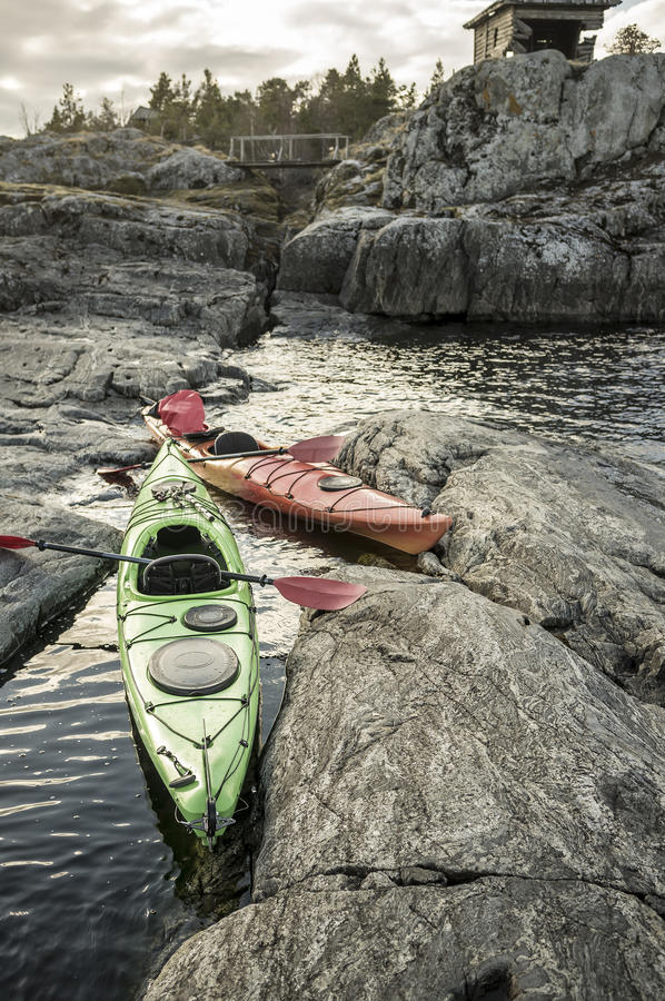 Download Kayaks Are Moored On The Rocky Shore In Background You Can Stock Photo
