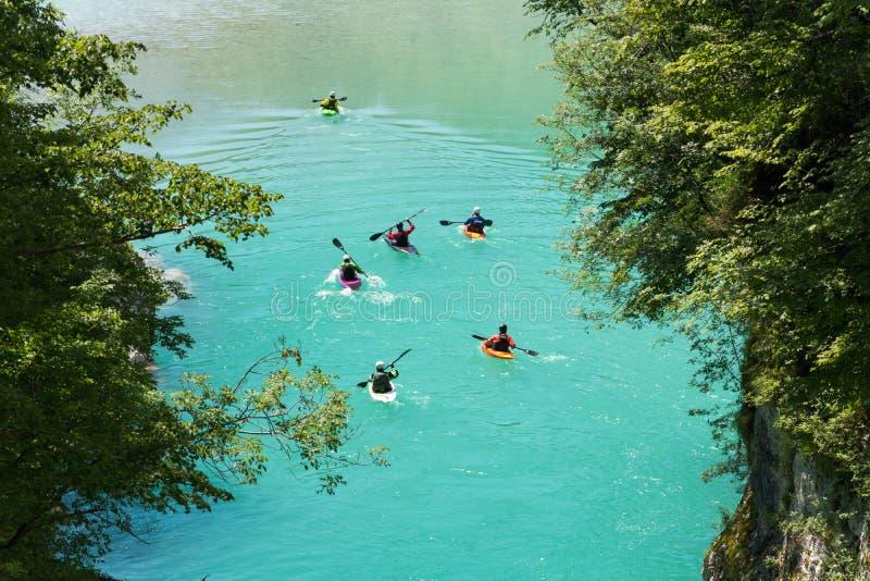 Kayaks on river Soca. Padeling in still water stock photos
