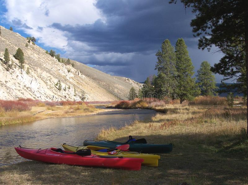 Kayaks at the River before the Storm