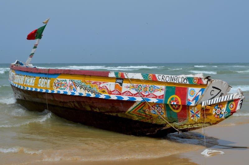 An artisanal fishing boat pirogue in Kayar/Cayar beach, north of Dakar. Kayar or Cayar is a small town in central Senegal, close to its capital Dakar. Most of stock photography