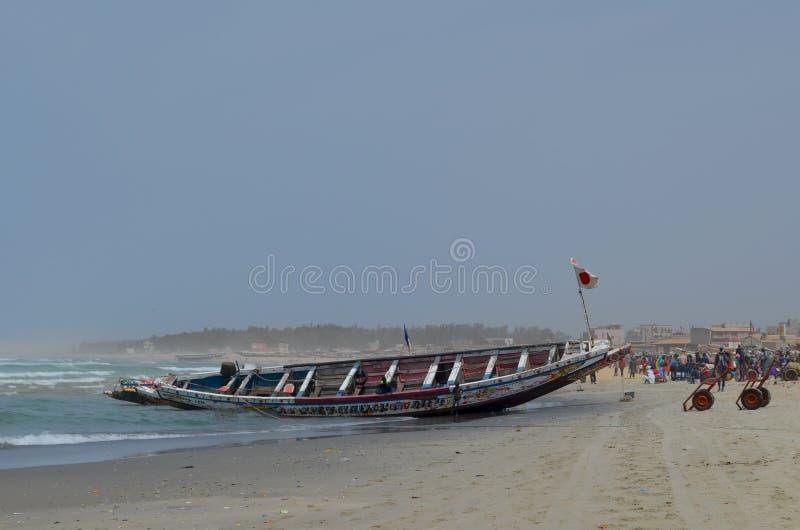 An artisanal fishing boat pirogue in Kayar/Cayar beach, north of Dakar. Kayar or Cayar is a small town in central Senegal, close to its capital Dakar. Most of royalty free stock photography