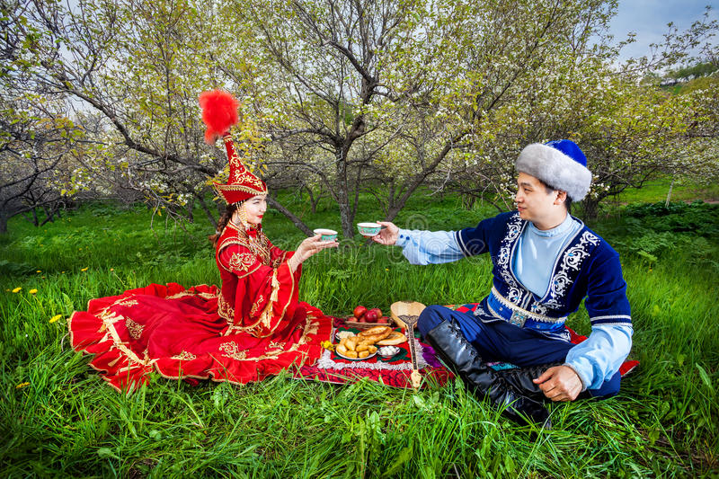 Kazakh couple in the garden royalty free stock image