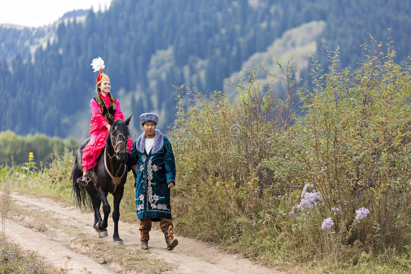 Kazakh couple in national costumes, Almaty, Kazakhstan royalty free stock image